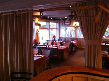 Conveniently tucked on one side of the dining room when not in use, the room-diving privacy curtains at the Salty's redondo location, are barely noticeable when not being utilized. To the degree they are noticeable while not in use, the curtains provide a touch of elegance.